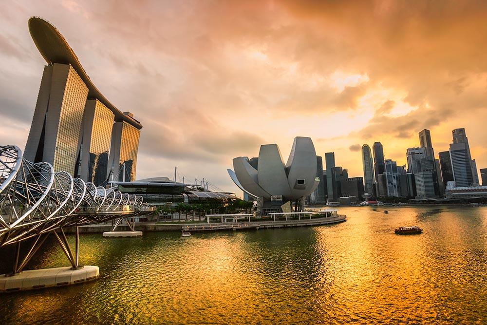 Singapore city skyline at sunset.