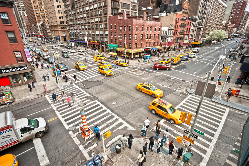 NEW YORK – MARCH 21: City streetlife in point of intersection of