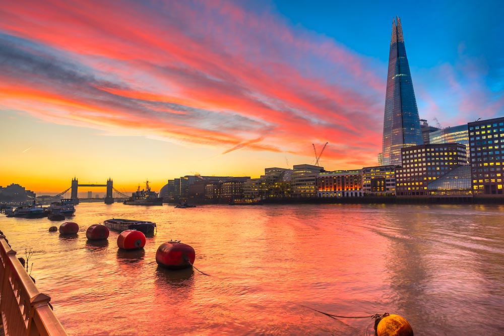 sunset over London, with the Shard and London Bridge. London, UK